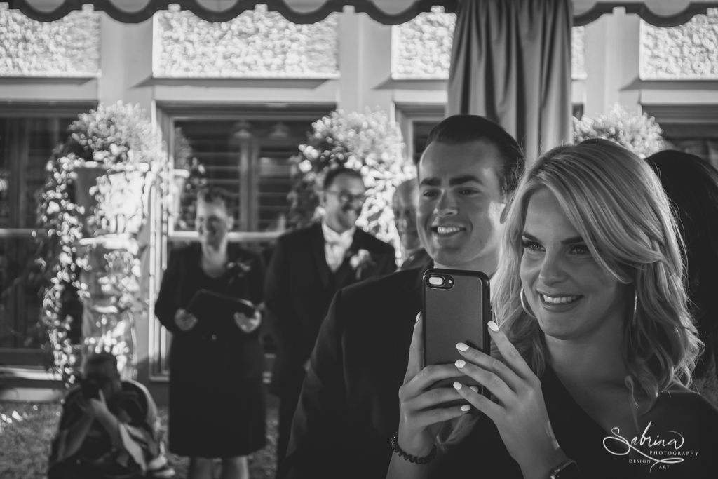 Guest Using Cell Phone at a Wedding