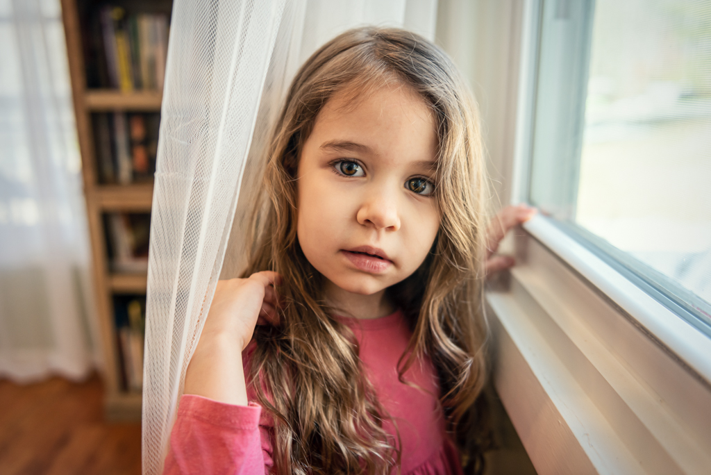 Girl in Front of a Window