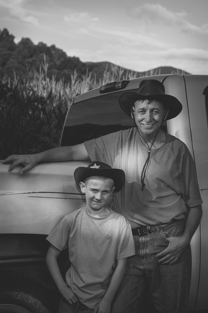 Child posed with Grandfather in the Country