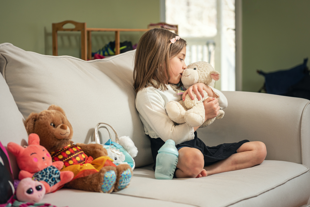 Girl Playing with Her Toys on Her Couch